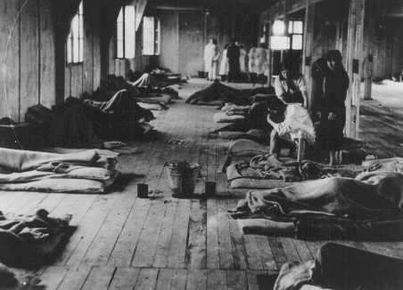 Women prisoners lie on thin mattresses on the floor of a barracks in the women's camp in the Theresienstadt ghetto